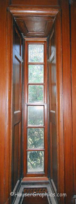 Palladian side window in Fenwick Hall with the wood paneling detail of the window surround.